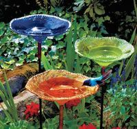 I may have to start looking for glassware so I can make some garden totems/bird baths.  Great way to add color in a shady yard where flowers won't grow.