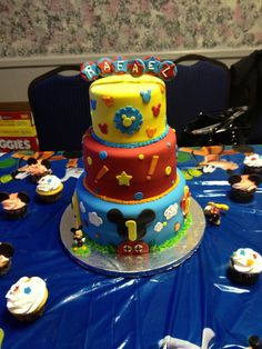 MIckey mouse clubhouse 1st birthday - 6, 8, and 10 in cake tiers. covered in fondant with fondant and buttercream accents.