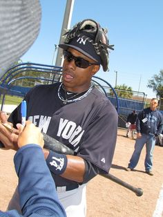 He was awesome coming out to sign autographs after the Yankees/Braves game--glove on his head and all! Major League Baseball Teams, Mlb Teams, Sports Teams, Baseball Players, Curtis Granderson, Braves Game, Yankees Baby, Famous Sports, Better Baseball