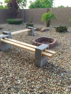 Garden Arbors To Make Your Garden More Beautiful A-unique-DIY-Cinder-Block-Bench-in-the-backyard-with-a-round-firepit-concrete-fe. A-unique-DIY-Cinder-Block-Bench-in-the-backyard-with-a-round-firepit-concrete-fe. Cozy Backyard, Fire Pit Backyard, Backyard Landscaping, Backyard Seating, Backyard Ideas, Firepit Ideas, Landscaping Ideas, Cinder Block Bench, Cinder Block Garden