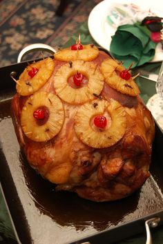 Holiday Pineapple and Cherry Glazed Ham -  This has been our go to Holiday ham as long as I can remember and this is what everyone expects when they come over, no if and or buts about it!!