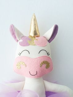 This unicorn doll is made with love! She makes a wonderful birthday gift or stunning decor for a unicorn party! She is about 15 inches tall not including her horn and made from high quality cotton fabrics and wool blend felt accessories. Her face is hand embroidered. Her outfit