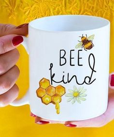 Enjoy sipping your favorite hot beverage from this delightful ceramic mug that's brimming with bee-inspired charm and style. Full graphic text: Bee kind (pun about W x H x DHolds 15 oz. Cute Coffee Mugs, Cool Mugs, Tea Mugs, Coffee Cups, Coffee Coffee, Painted Coffee Mugs, Coffee Beans, Stars Disney, Crackpot Café