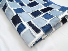 Here is a beautiful patchwork ticker tape quilt made from denim fabric scraps. Would look nice to use on the end of a single bed, used as a