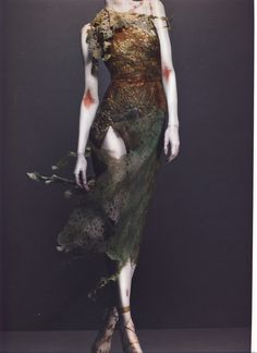 """Alexander McQueen Autumn/Winter 1995-96  Dress, Highland Rape Dress of green and bronze cotton/synthetic lace   Photographed by Sølve Sundsbø for Alexander McQueen: Savage Beauty   """"[This collection] was a shout against English designers... doing flamboyant Scottish clothes. My father's family originates from the Isle of Skye, and I'd studied the history of the Scottish upheavals and the Clearances. People were so unintelligent they thought this was about women being raped - yet Highland…"""
