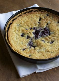 Recipe for blackberry cobbler, cooked in an iron skillet.