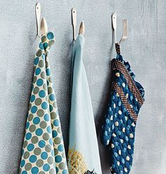 add magnets to bent spoons, stick to fridge, hang up potholders & towel