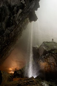 "Conquering an Infinite Cave - Vietnam's Hang Son Doong Cave  16 - ""It sounded like a roaring train,"" said ""Sweeny"" Sewell, describing the noise a second before a waterfall exploded into Hang Son Doong through the Watch Out for Dinosaurs doline, or sinkhole opening.   A rare dry-season downpour produced the thundering runoff. Were the cavers scared of drowning? ""Maybe if it were a smaller cave,"" said expedition leader Howard Limbert, ""but not here."""