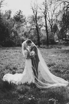 So cute... instead of pulling back the veil to reveal her he gets under to join :)