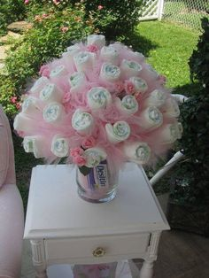 "A Diaper Bouquet. Diapers because the ""flowers"" with some tulle (perhaps tutu.... *** See more by going to the photo link Learn more at  http://kitchenfunwithmy3sons.com/2016/06/20-best-baby-shower-ideas.html/"