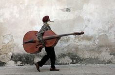 I was in Havana Cuba in 2013 with several friends and I followed Cuban Cool while he was walking across the street from the outdoor café I was at. He probably was heading to a Gig to be discovered. It wasn't until he walked in front of this wall,...