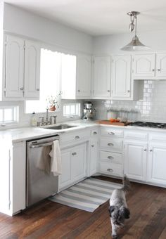 a classic white kitchen with stainless steel appliances
