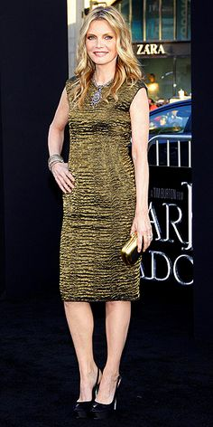 MICHELLE PFEIFFER  Also attending the Dark Shadows Hollywood premiere, the ageless actress sports one of the most popular colors of the night in the form of a liquid gold dress, accessorized with a coordinating clutch and sparkling jewels.