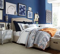 Table linens from a historical parlor room were the inspiration for this rich pattern, redrawn in cool hues and earthen tones for a fresh update to the bedroom. Royal Blue Walls, Royal Blue Bedrooms, Navy Walls, Blue Rooms, White Walls, Country Look, Curved Bed, Parlor Room, Bedroom Orange