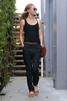 PEG — Black top, navy casual pants, sandals, shoulder bag.