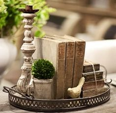 Decorate a tray, flowers, candles, and fave pic of couple instead of books . . .