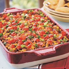 Nacho Grande Casserole | By: | Carol Hickman, Kingsport, TN, Gooseberry Patch Keepsake Cookbook | August 2012 | Instead of serving a spicy ground beef nacho mixture on a platter over tortilla chips, bake it in a casserole and serve with chips for a hearty main dish or appetizer. | Via: myrecipes.com