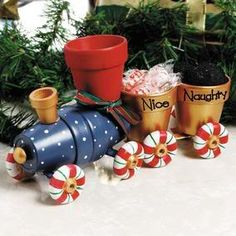Clay Pot Choo Choo Train. Could be cute without being Christmasy too Clay Pot Projects, Clay Pot Crafts, Diy Clay, Holiday Crafts, Diy Crafts, Shell Crafts, Handmade Crafts, Flower Pot Art, Clay Flower Pots