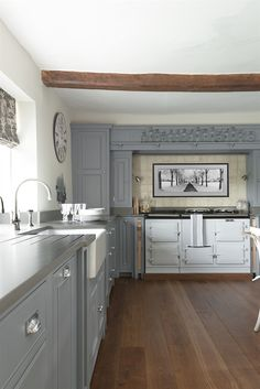 Very pleasing colour scheme - and aga - in this Neptune kitchen.