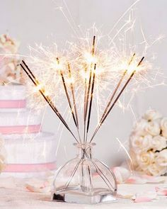 Sparklers... maybe for the cake table when you're cutting it.  I think it would make for good pictures.