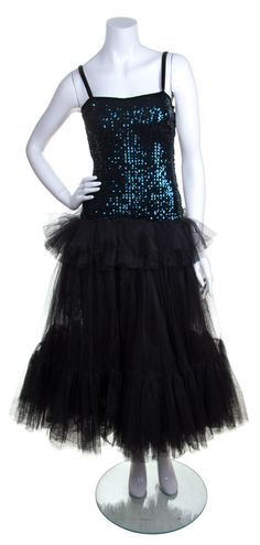 An Yves Saint Laurent Blue Sequined and Black Tulle Cocktail Dress    Luxury Accessories and Couture auction   September 13-14, 2016 in Chicago