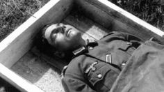 This young German is as if sleeping in his final resting place. Whenever possible, the Germans would use wooden coffins for their KIAs and bury them in clean uniforms.