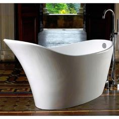 Softly contoured sides flow gracefully uncluttered by waste pipe work and an extended backrest provides full head support; Carron Baths, Family Bathroom, Victoria And Albert, Amalfi, Freestanding Bath, Luxury, Yorkshire, Design