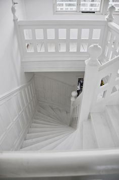 White Hallway, White Staircase, Interior Staircase, Painted Deck Floors, Stairwell Decorating, Arched Cabin, Condo Remodel, House Entrance, 2nd Floor