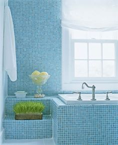Bathroom Remodeled for Relaxation:  Wow.  The blue glass tiles invite you in to escape the worries of the world.  I'm feeling more relaxed just looking at the pictures!