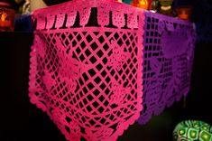 Papel picado: Delicately decorated tissue paper is used to represent wind and the fragility of life.