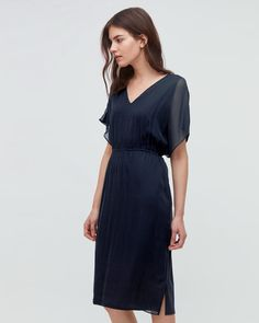 A new shape for the season, this beautiful dress is made from a soft modal and cotton mix with a silk front overlay. It can be worn two ways by simply altering the waist tie. Tie at the front for a contemporary and slightly more casual look, or tie at the back for a classic, occasion look. Other features include a V-neckline, wide, short sleeves and gentle gathers from waist to hem. Wear this piece with heels or flats.