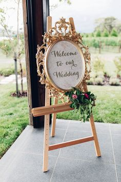 Gold Guilt Oval Ornate Frame Wedding Sign | Elegant Metallic Gold & Red Wedding Inspiration | Rockstars and Royalty Dresses | Peony N' Pearl Florist | Swish Vintage Canberra | Miss Gen Photography | http://www.rockmywedding.co.uk/elegant-metallic-gold-red-wedding-inspiration/