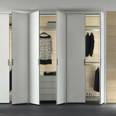 composition Cover with aluminum frame, doors in white matt lacquered glass, aluminum and transparent gray glass shelves, drawers on wheels in matt white lacquered glass, aluminum rods hangers. Wardrobe Handles, Wardrobe Closet, Walk In Closet, Closet Shelves, Closet Doors, Wall Shelves, Drawers On Wheels, Glass Display Shelves, Shelves For Sale