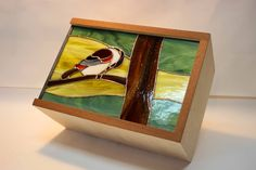 A wooden box with a stained glass of 7 by 11 inches. Creation of  Frederick Pigeon at Atelier Vitrum