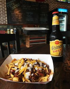 Smoked brisket chili Frito Pie, infused with 8th Wonder Rocket Fuel from 8th Wonder Brewery #BBQ #HouBBQ #FritoPie #chili #PappaCharlies