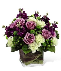 2013 Wedding Trends: Purple and Green flowers. The Beloved Blooms centerpiece from GrowerDirect.com. Perfect for a spring or summer wedding! #flowers #wedding