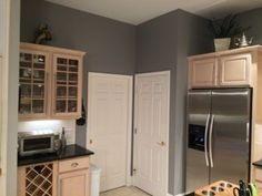 Grey Kitchen Walls With Oak Cabinets sherwin-williams functional gray - to de-pink pickled oak cabinets