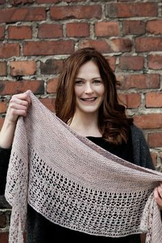 Rosewater is ethereal and elegant shawl with garter stitch body and modern lace border featuring eyelets and dropped stitches - find the pattern on LoveKnitting!