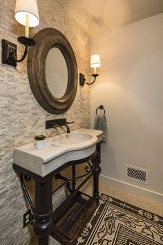 Mediterranean Powder Room with High ceiling, Limestone Tile, Wall sconce, Limestone counters, Carpet, Powder room, Stone Tile