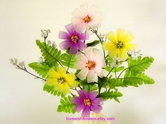 Beautifully coreopsis are very pure and lovely. The flower language is good and Harmonious. Different colors for Home decor abstract Flower. Handcraft nylon fabric flower and leave. Flowers different size approximately 2 inches- 4 inches (5cm-10cm) in diameter and 2 inches (5cm)