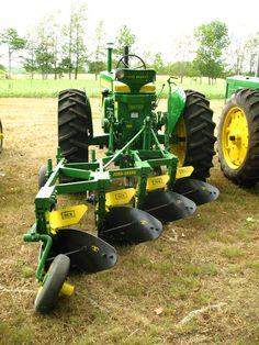 John Deere 720 with plow
