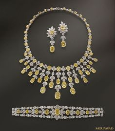 Mouawad yellow and clear diamond bracelet, earrings, and necklace