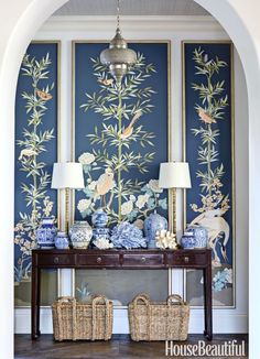 """I like making a statement in an entry,"" says designer Summer Thornton, who commissioned custom panels and massed blue-and-white porcelain for a Florida home's foyer. Click through for more amazing designer entryways to inspire your next reno."