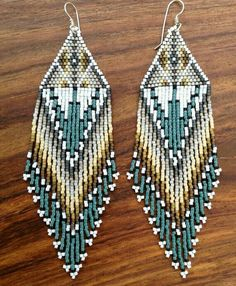 I design and handweave each pair of earrings using delica seed beads, nylon thread and handmade sterling silver or gold filled ear wires. Beaded Earrings Native, Beaded Earrings Patterns, Native Beadwork, Seed Bead Patterns, Beading Patterns, Fringe Earrings, Seed Bead Jewelry, Seed Bead Earrings, Mint Earrings