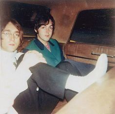 John Lennon and Paul McCartney (we're just busy riding...sitting in the back seat of my car..)