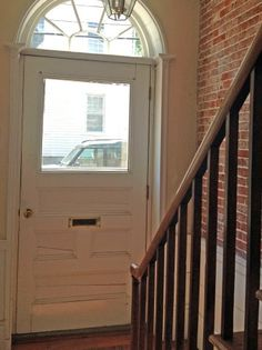 This main entry staircase will be restored along with the existing door and window on this Middle Street remodeling project in Newburyport