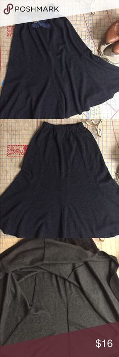 """Gored charcoal skirt size small In excellent condition. Made from sweatshirt material so really soft. Knee length and gored. Has a retro feel. Elastic Waist. Waist measures 11"""" unstretched and skirt length is 29-30"""". Why just be cute when you can be cute and comfortable? Skirts Midi"""