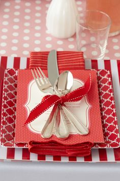 The Perfect Setting. Baby shower silverware seems sweeter when wrapped lovingly with a bow.