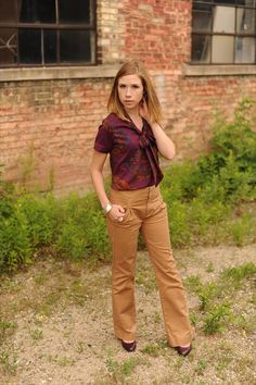 Cute business outfit. Flowy blouse tucked into dress pants. Wear with heels