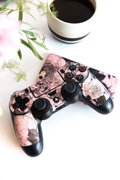 Shop the official Skinit Rose Quartz Floral Playstation Skin design online. Show off your art style & buy a Rose Quartz Floral Skin for any Playstation. Control Ps4, We All Mad Here, Ps4 Skins, Video Game Rooms, Game Room Design, Ps4 Controller, Gamer Room, Ps4 Games, Games Consoles
